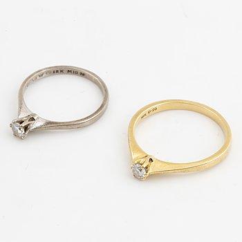 Two brilliant-cut diamond rings.