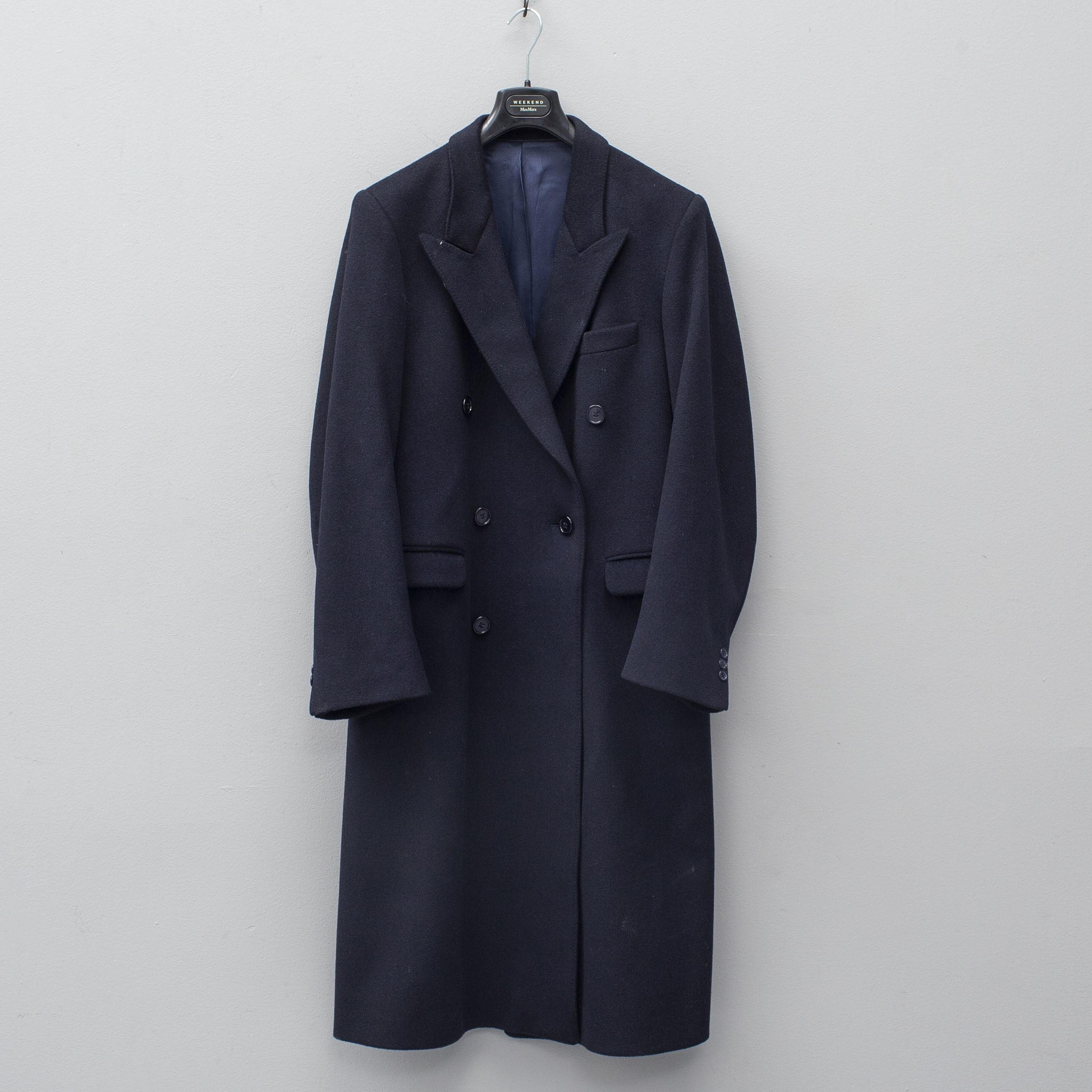 2dcbb103c62 YVES SAINT LAURENT, a navy wool coat. - Bukowskis