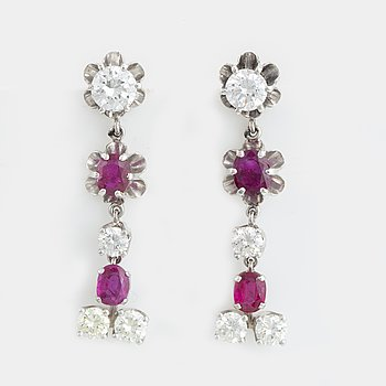 Oval faceted ruby and brilliant-cut diamond earrings.