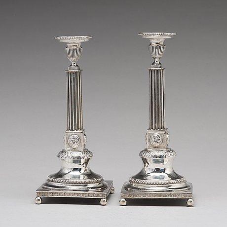 A pair of swedish 18th century silver candlesticks, mark of lars boye, stockholm 1792.