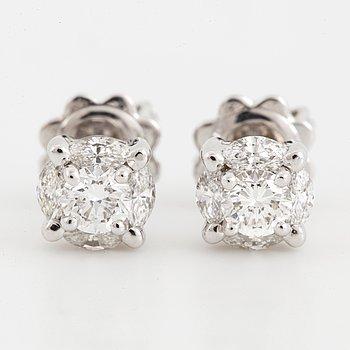 18K white gold, brilliant-cut and navette diamonds.