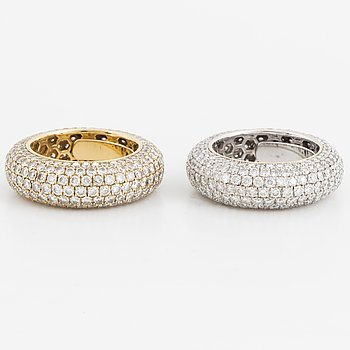 Two brilliant-cut diamond rings.