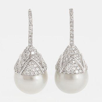 A pair of cultured South sea perl and diamond earrings.
