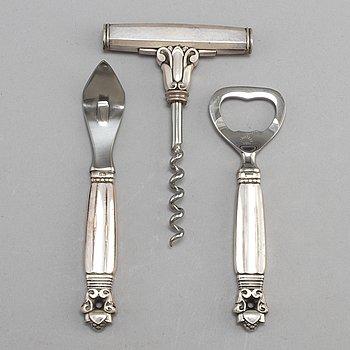 A Danish 20th century set of three Georg Jensen silver openers.