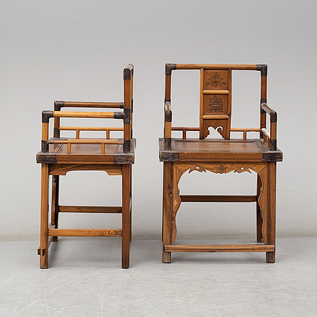 A pair of chinese wooden armchairs, early 20th century.