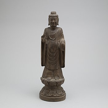 A stone sculpture of buddha,  South East Asia, 20th Century.