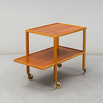 A second half of the 20th Century model 470 walnut serving trolley by Josef Frank from Firma Svenskt Tenn.