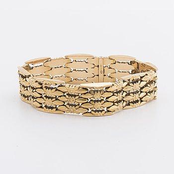 An 18 Carato gold bracelet ca 29,2 gr.