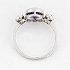 Ring, med rund fasettslipad färgväxlande blålila safir och gammalslipade diamanter, med certifikat gem & pearl lab