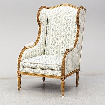 An early 20th Century Louis XVI-style easy chair.