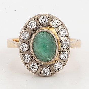 Cabochon-cut emerald and brilliant-cut diamond cluster ring.