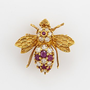18K gold diamond and ruby brooch.