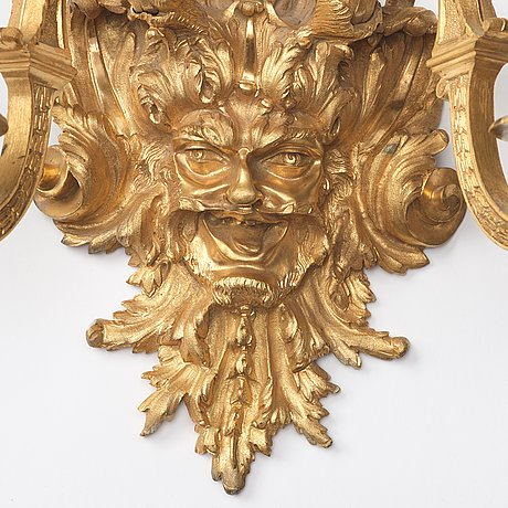 A pair of baroque-style mid 19th century two-light wall-lights.