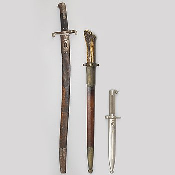 A hunting sword and two bayonets with scabbards.