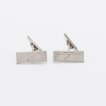 A Swedish 20th century pair of strling cuff links mark of Wiwen Nilsson Lund 1951, weight ca 12,4 gr, length ca 2,2 cm.