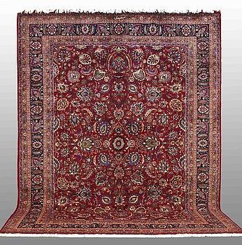 A carpet, Mashad, signed, around 403 x 302 cm.