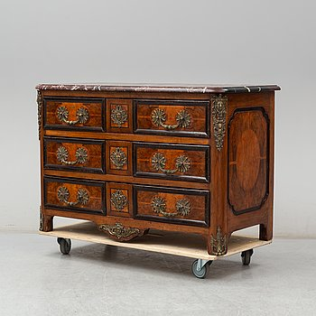 A 20th century French Regence style commode.