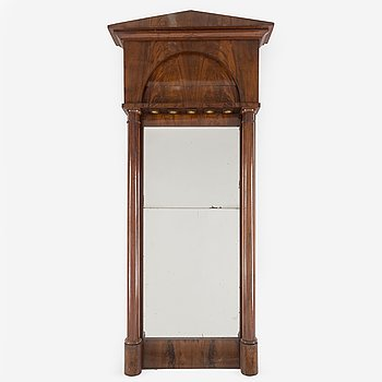 A first half of the 19th century mahogany veneered mirror.