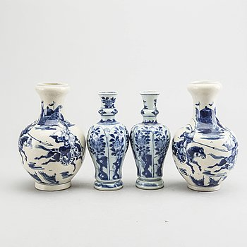 A set of two pairs of Kangxi and Kangxi style blue and white porcelain vases.