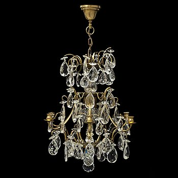 An early 20th Century chandelier with glass prisms.