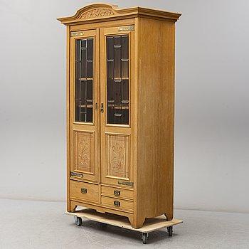 An early 20th century art noveau cabinet.