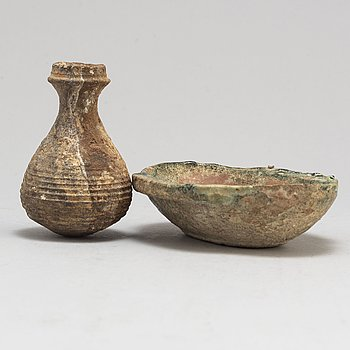 A pottery wine goblet and a vase, the green glazed goblet Han dynasty (206 BC-220 AD).