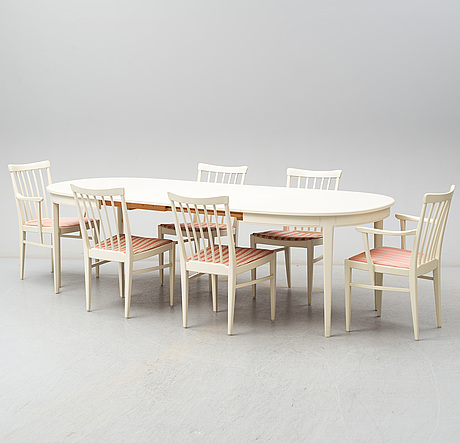 A dining table with four chairrs and two armchairs by carl malmsten from Åfors