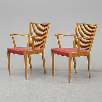 A mid 20th Century elm wood armchairs.