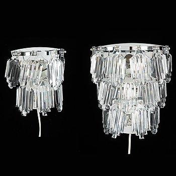 A pair of chrome and crystal wall lights from ÖIA Örsjö Belysning an Orrefors.