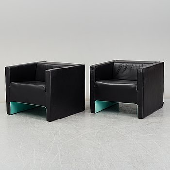 A contemporary pair of 'Davos' easy chairs by Jeffrey Bernett, from Viccarbe.