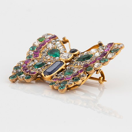 A butterfly brooch/pendant in 14k gold set with old-cut diamonds.