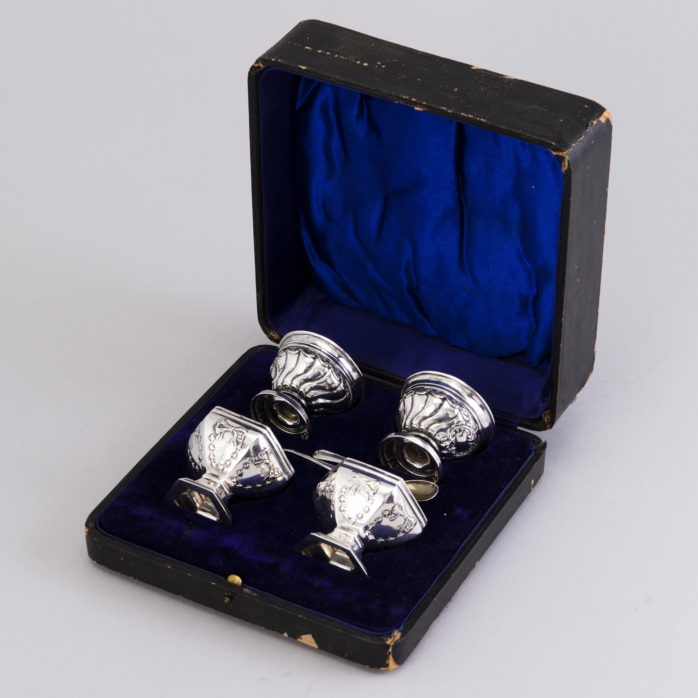A sugar bowl, eight salt spoons and four salt cellars, 19th