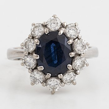 Sapphire and brilliant-cut diamond cluster ring.