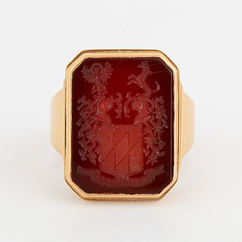 Carnelian signet ring with coat of arms.