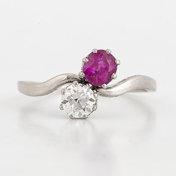 Ruby and diamond crossover ring.