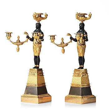 102. A pair of Empire three-light candelabra, circa 1810.