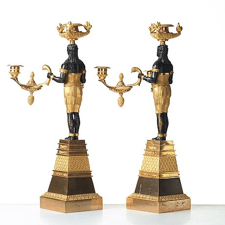 A pair of empire three-light candelabra, circa 1810.