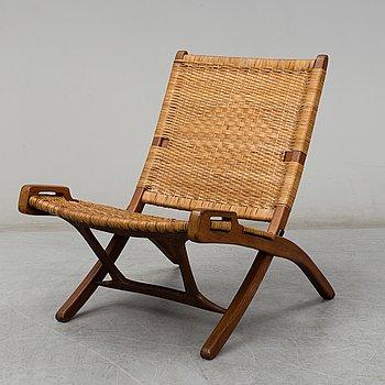 A 'Folding Chair by Hans J Wegner, Denmark, designed in 1949.
