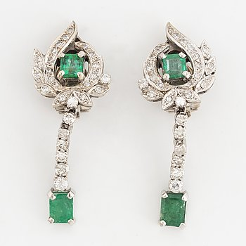 Emerald and diamond earrings.