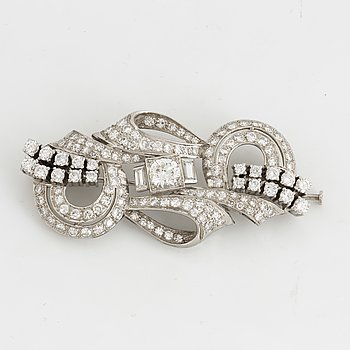 Platinum and round brilliant-, eight- and baguette-cut diamond brooch.