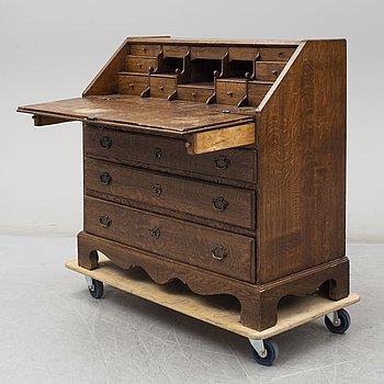 A mid 18th century oak secretaire.