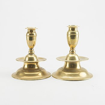 A set of two late Baroque brass candelsticks.