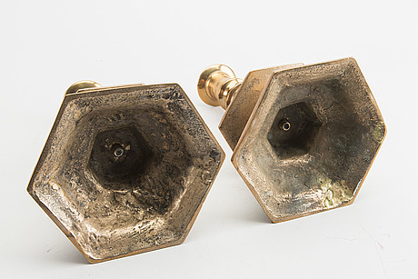 A set of two baroque-style brass candles ticks.