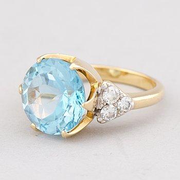 A RING, facetted topaz, diamonds, 18K gold. A. Tillander, Helsinki 2009.