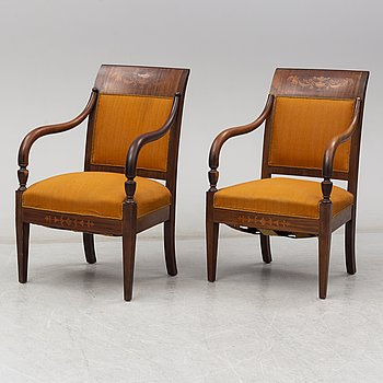 A pair of early 20th century empire style chairs.