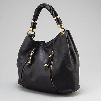 MICHAEL KORS, a black leather handbag.