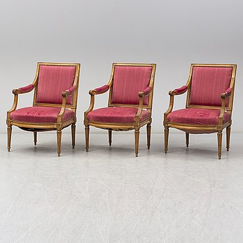Three Louis XVI late 18th century armchairs.