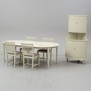 A dining table, four chairs and a corner cabinet, second half of the 20th century.