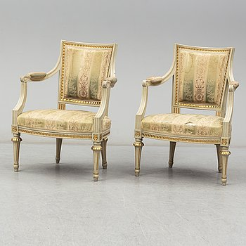A pair of gustavian style chairs, early 20th century.