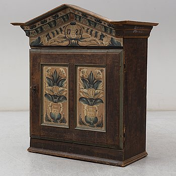 An 18th century folk art cabinet.